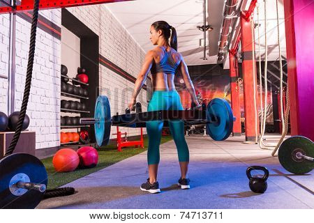 Hex Dead Lift Shrug Bar Deadlifts woman at gym workout weightlifting