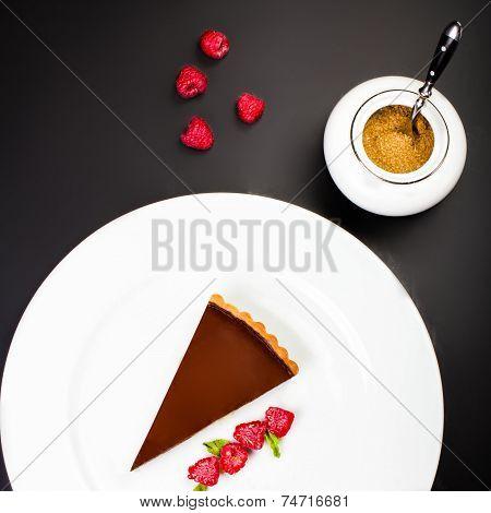 Chocolate Cheesecake With Raspberries. Dark Chocolate Cake With Chocolate Sauce Macro