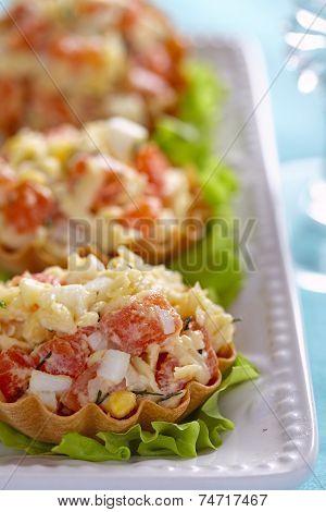 Tartlet stuffed with salmon salad