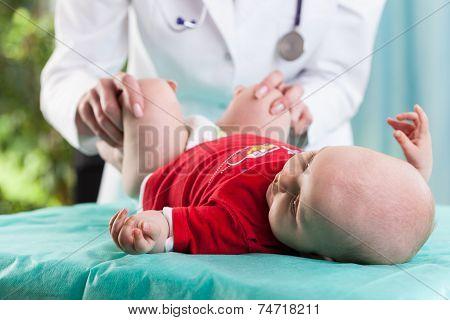 Doctor Examining Lying Baby
