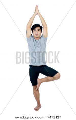 Handsome young man in yoga pose