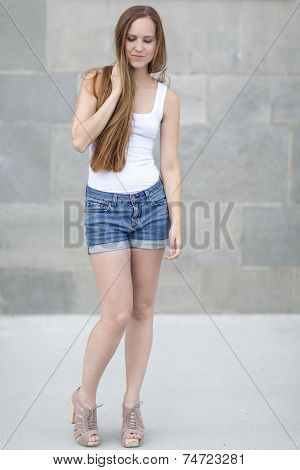 Beautiful and smiling nordic woman in shorts