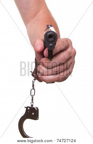 Male Hand In Police Handcuffs And A Gun Isolated On A White Background