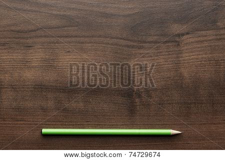 green pencil on the table