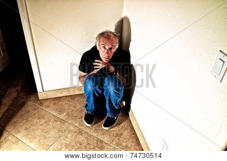 Older Man In Empty Room Terrified