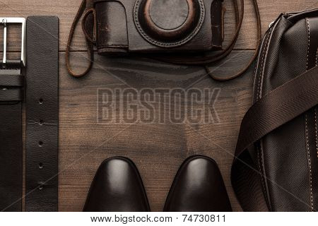 brown shoes, belt, bag and film camera frame
