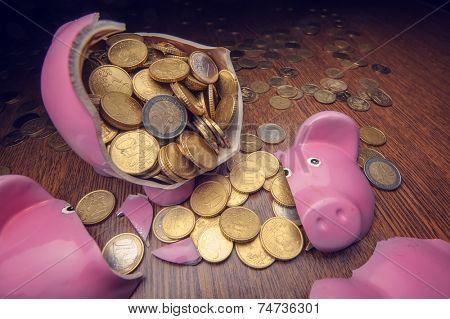 cracked pink pig moneybox closeup