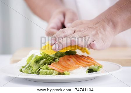 Chef's Hands Cutting Yellow Bell Pepper