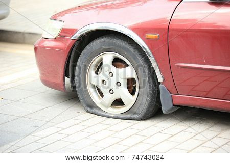 flat tire on car wheel