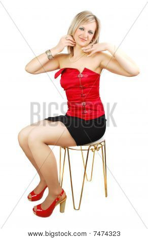 Attractive Woman On The Stool