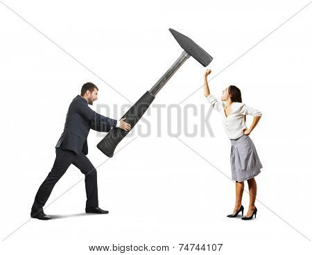 concept photo of conflict between man and woman. angry screaming man holding big hammer and hitting, woman showing fist and shouting. photo over white background