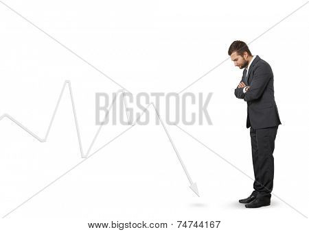 displeased man looking at downturn graph. isolated on white background