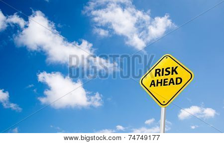Risk Ahead Sign On Sky