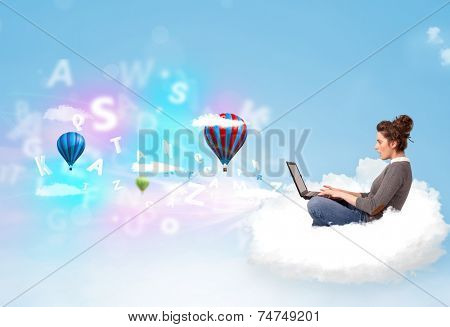 Pretty young woman sitting in cloud with laptop, balloons and letters concept