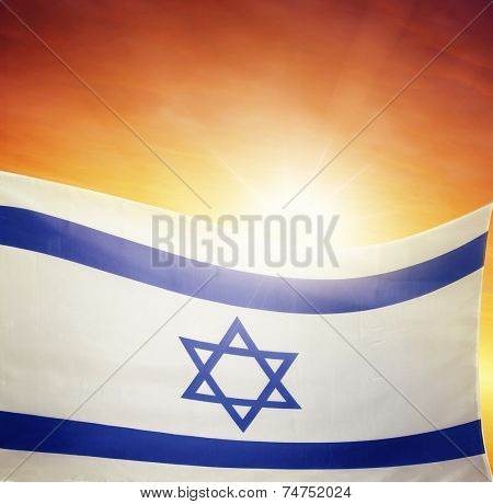 Israeli flag in front of bright sky