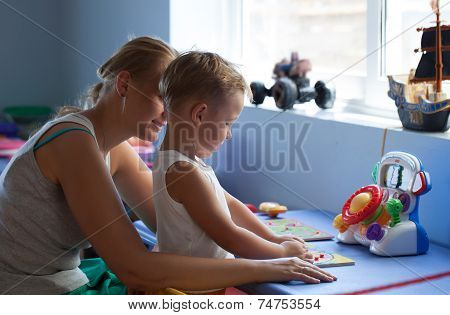 Mother playing learning game with son