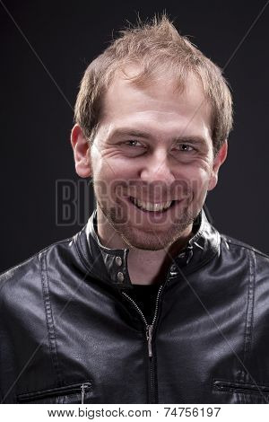 Portrait of a man with leather jacket smiling