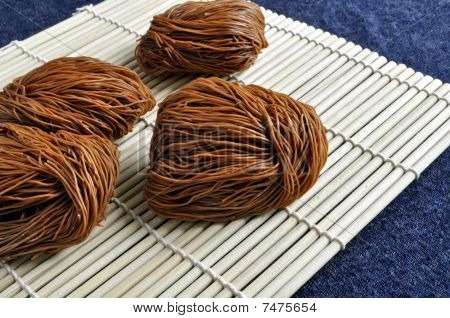 Dried noodles on bamboo mat