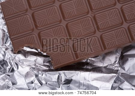 Bitten chocolate with silver foil