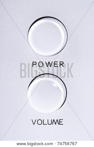 Power and volume buttons on audio speakers