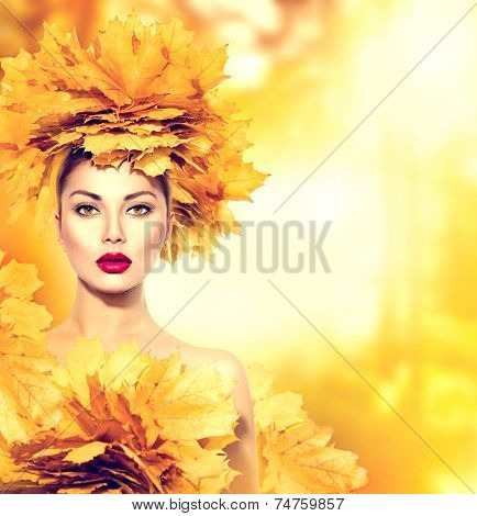 Autumn woman with yellow leaves hair style. Autumn Lady Portrait. Beauty Fashion Model Girl with Autumnal Make up and Hairstyle. Fall. Creative Autumn Makeup. Beautiful Face