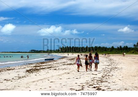 women walking on the beach in Alagoas Brazil