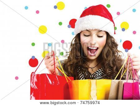 Christmas shopping concept, Christmas gifts, Christmas sales. Beautiful surprised woman with colorful shopping bags isolated on a white background