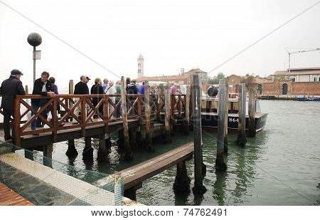 Tourists In Murano