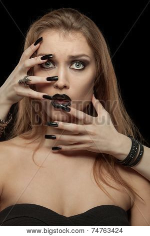 Gothic woman with hands of vampire on her face. Halloween