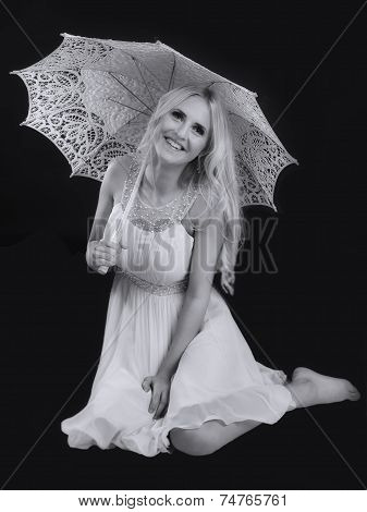 Blond girl with umbrella