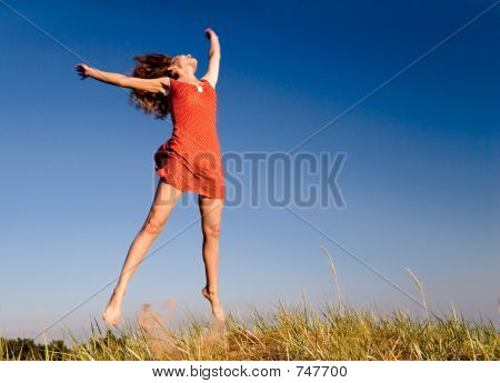 Girl jumping on a dune-1
