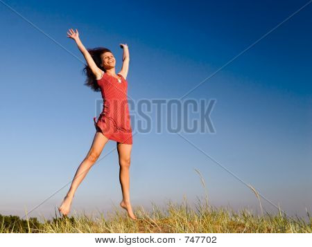 Girl jumping on a dune-2