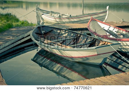 Floating Wooden Boats With Paddles