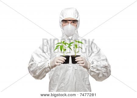 A man in uniform holding plants