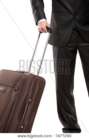 Business traveller with a suitcase isolated on white background