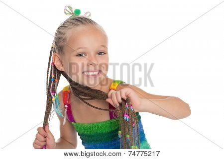 Cute little girl with dreadlocks in the hands on a white background. Girl is six years old.