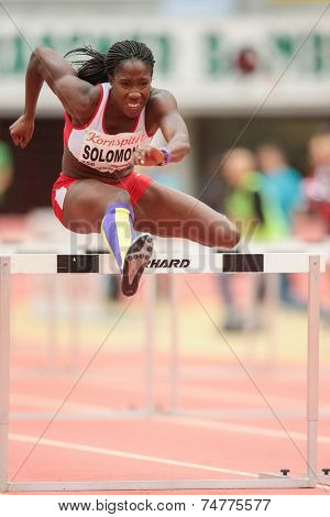 LINZ, AUSTRIA - JANUARY 30, 2014: Serita Solomon (#356 Great Britain) places 3rd in the women's 60m hurdles event in an indoor track and field meeting.