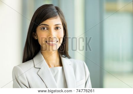 close up portrait of young indian business woman in modern office