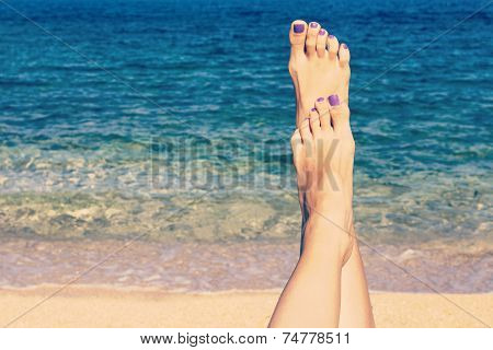 Relaxing On The Beach With Legs Up. Retro Look