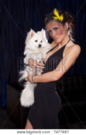 Young Widow Woman In Sexy Black Dress Hold In Hands White Dog And Flirting