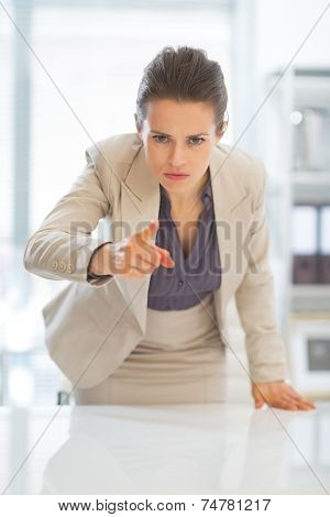 Concerned Business Woman Pointing In Camera