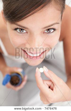 Pastillas / mujer de vitaminas