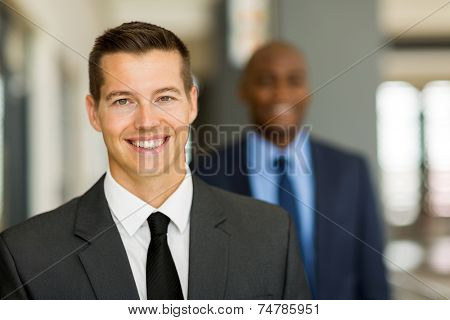 good looking young businessman looking at the camera