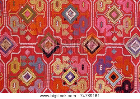 the fabric embroidered with oriental ornaments - background