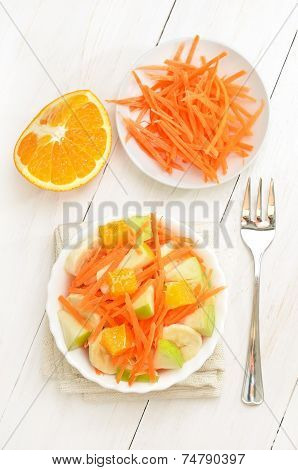 Fruit Salad On White Wooden Table