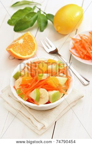 Fruit Salad In Bowl On White Wooden Table