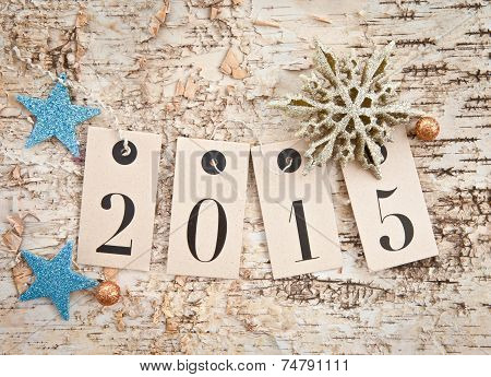 2015 On Rustic Wooden Background