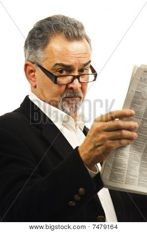 Older Businessman Reads His Newspaper.