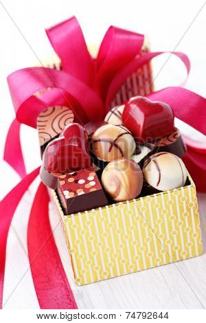 box of chocolates with red ribbon - sweet food
