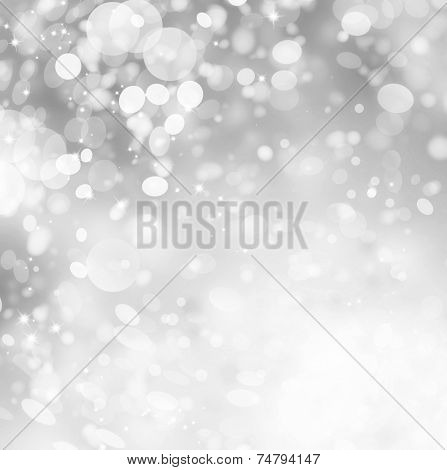 Christmas Grey Background. Silver Holiday Abstract Glitter Defocused Background With Blinking Stars and Snowflakes. Snow Blurred Bokeh